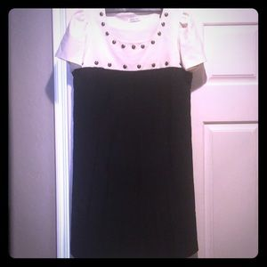 Dress with studs and pleated skirt
